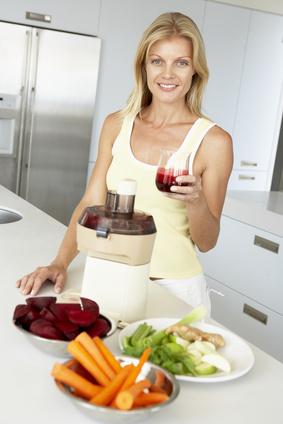 Mid Adult Woman Making Fresh Vegetable Juice